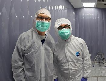 Michael Turner and Luca Grandi inside the Xenon1T detector.