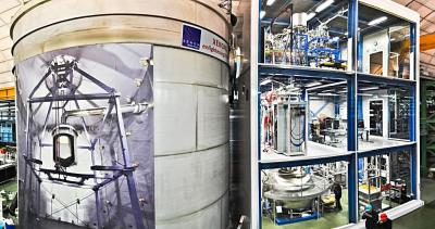 XENON1T installation in the underground hall of Laboratori Nazionali del Gran Sasso. The three story building on the right houses various auxiliary systems. The cryostat containing the LXeTPC is located inside the large water tank on the left. <i>Photo by Roberto Corrieri and Patrick De Perio</i>