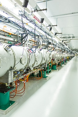 SNS's Beamline 13, which carries neutrons from the SNS collider to experimental stations. The same process that produces the neutrons also spits out neutrinos, which enter the COHERENT detector in the SNS basement.  <i>Credit: Jean Lachat University of Chicago.</i>