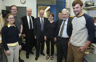 Fred Kavli (center) visits the KICP in 2004