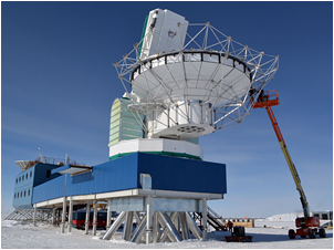 Construction workers on a lift assemble the metal superstructure for the ground shield on the South Pole Telescope during the 2011-12 field season. The shield will eliminate ground reflection inteference as the telescope begins a new experiment on cosmic inflation.   Photo Credit: Peter Rejcek
