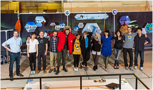 Bo Rodda (far left), and members of his Manifest SPACE class at the School of the Art Institute Chicago gather in front of the South Pole Telescope exhibit, which they produced as a class project.