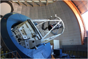 The Dark Energy Camera, mounted on the Blanco telescope in Chile, is the most powerful sky-mapping machine ever created. It has captured and recorded ancient starlight for the first time. <i>Courtesy of Dark Energy Survey Collaboration</i>